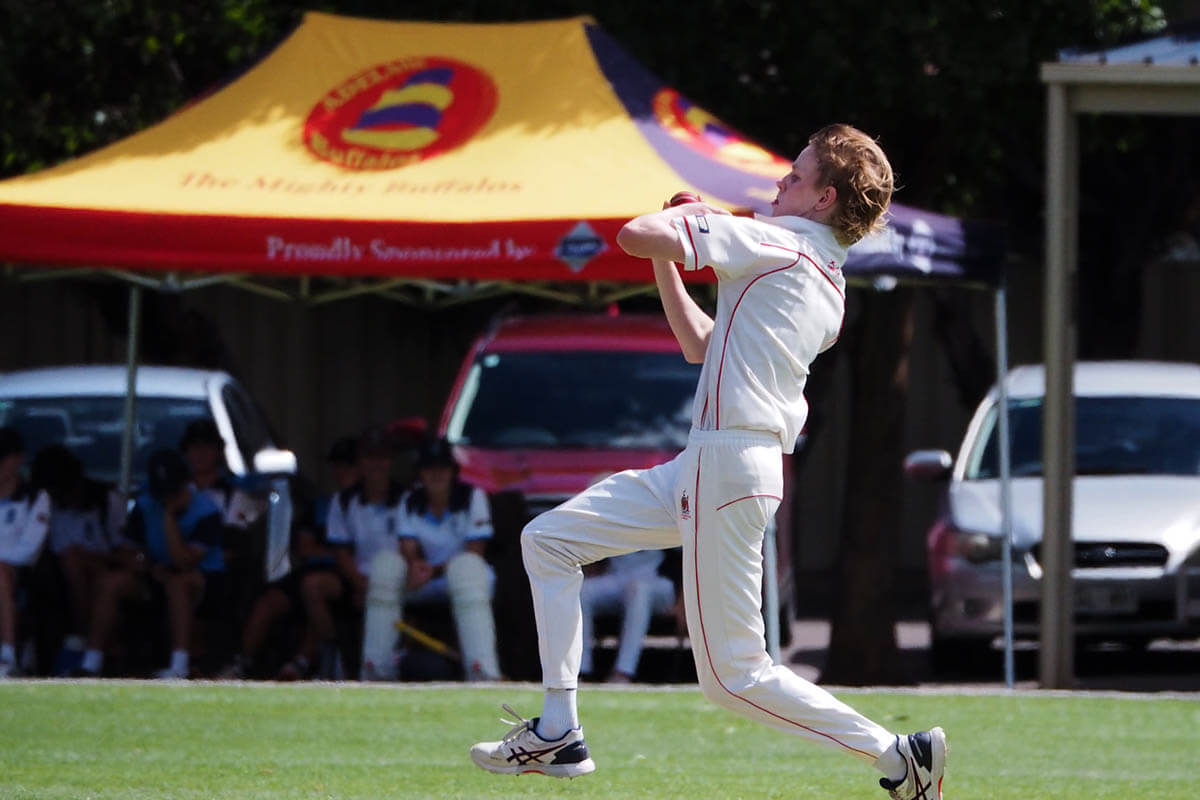 Cricket Club Marquee With Person Bowling